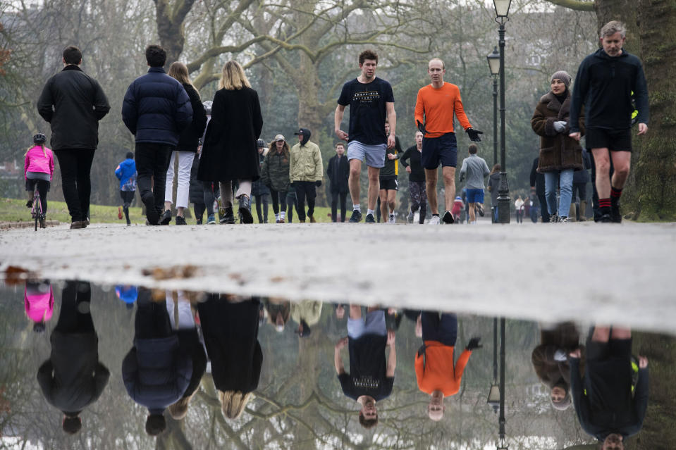 People walk through Battersea Park, in London, during England's third national lockdown to curb the spread of coronavirus, Saturday, Jan. 23, 2021. (Kirsty O'Connor/PA via AP)