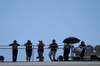 People watch a NASCAR Xfinity Series auto race at Charlotte Motor Speedway, Saturday, May 29, 2021, in Charlotte, N.C. (AP Photo/Ben Gray)