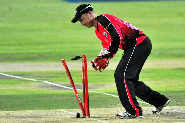 Brad Haddin of the Sixers runs out Chris Morris of the Lions during the Karbonn Smart CLT20 Final match between bizhub Highveld Lions and Sydney Sixers at Bidvest Wanderers Stadium on October 28, 2012 in Johannesburg, South Africa. (Photo by Duif du Toit/Gallo Images/Getty Images)