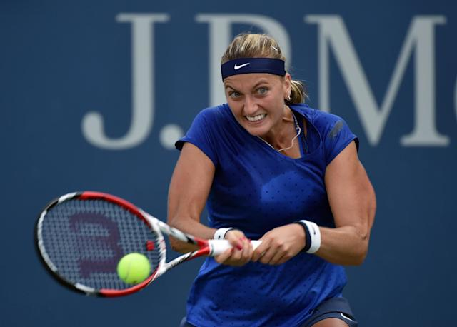 Petra Kvitova of the Czech Republic returns a shot to Petra Cetkovska of the Czech Republic during their 2014 US Open women's singles match on August 28, 2014 in New York (AFP Photo/Stan Honda)