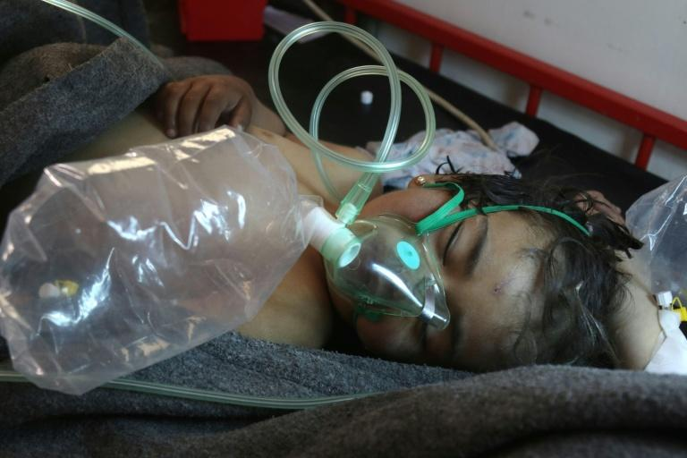 A Syrian child receives treatment at a small hospital in the town of Maaret al-Noman following a suspected toxic gas attack in Khan Sheikhun on April 4, 2017