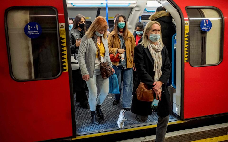 Commuters wear face-masks during morning rush hour on the Victoria Line of the London Underground in central London on October 16, 2020, as the number of novel coronavirus COVID-19 cases - Tolga Akmen/AFP