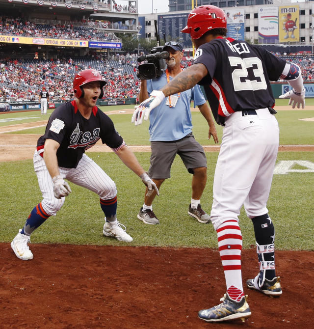 U.S. Team Peter Alonso, of the New York Mets celebrates his two-run homer against the World Team in the seventh inning of the All-Star Futures baseball game, Sunday, July 15, 2018, at Nationals Park, in Washington. The the 89th MLB baseball All-Star Game will be played Tuesday. (AP Photo/Alex Brandon)