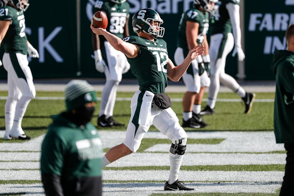 Michigan State quarterback Rocky Lombardi (12) warms up ahead of the Indiana game at Spartan Stadium in East Lansing, Saturday, Nov. 14, 2020.