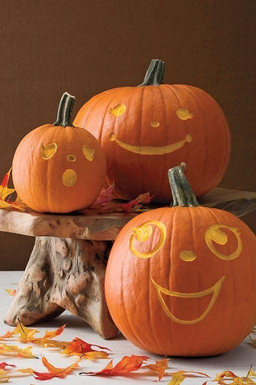 """<p>Great guests with a gaggle of smiling faces. These etched pumpkins don't requires scooping, so they'll result in little to no cleanup.</p><p><strong>Get the tutorial at <a href=""""https://www.womansday.com/home/crafts-projects/a28580830/groovy-gourds/"""" rel=""""nofollow noopener"""" target=""""_blank"""" data-ylk=""""slk:Woman's Day"""" class=""""link rapid-noclick-resp"""">Woman's Day</a>.</strong> </p>"""