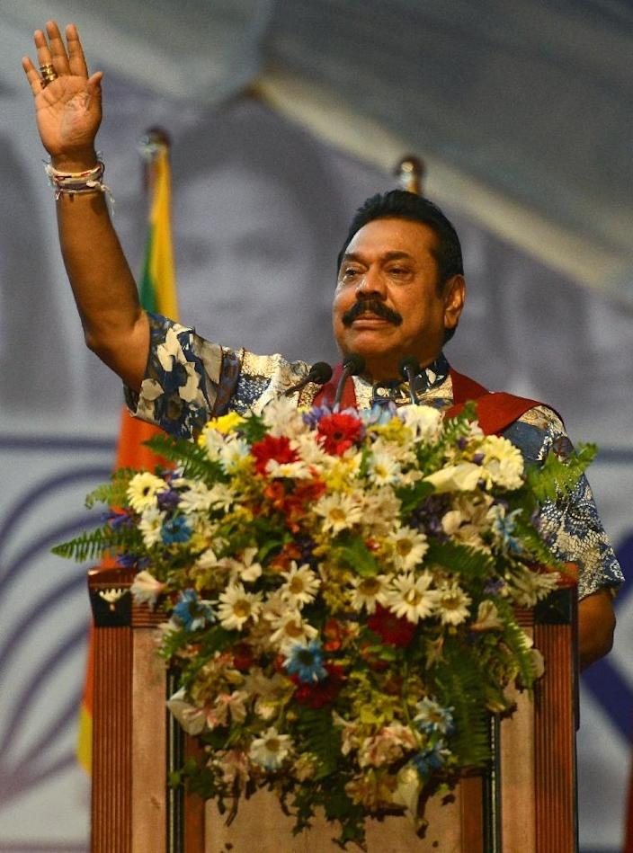 Former Sri Lankan president Mahinda Rajapakse, pictured here on January 5, 2015, is accused of siphoning off billions of dollars during his nine-year rule (AFP Photo/Lakruwan Wanniarachchi)