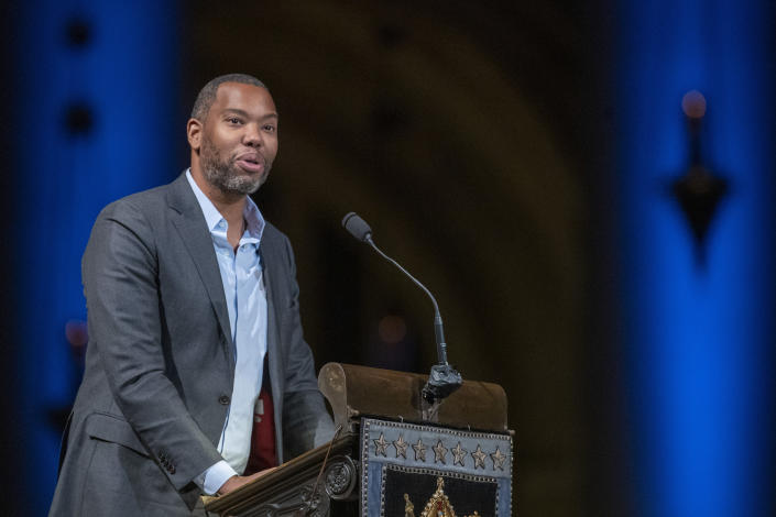 FILE - In this Nov. 21, 2019 file photo, author Ta-Nehisi Coates speaks during the Celebration of the Life of Toni Morrison at the Cathedral of St. John the Divine in New York. This past week's hiring of Nikole Hannah-Jones and Coates serves as confirmation that Howard University intends to dive neck-deep into America's divisive racial debate. (AP Photo/Mary Altaffer, File)