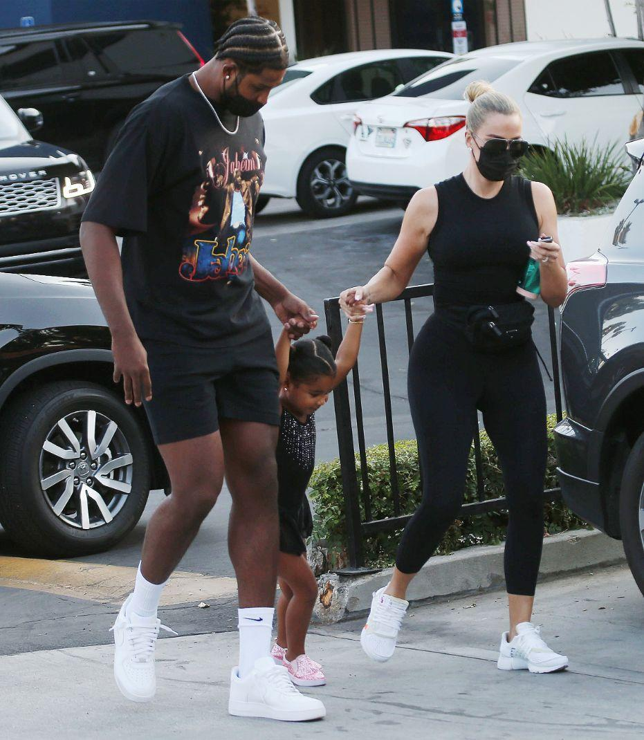 Khloe Kardashian and Tristan Thompson out for a walk with their daughter True in Los Angeles on September 20.  - Credit: MEGA