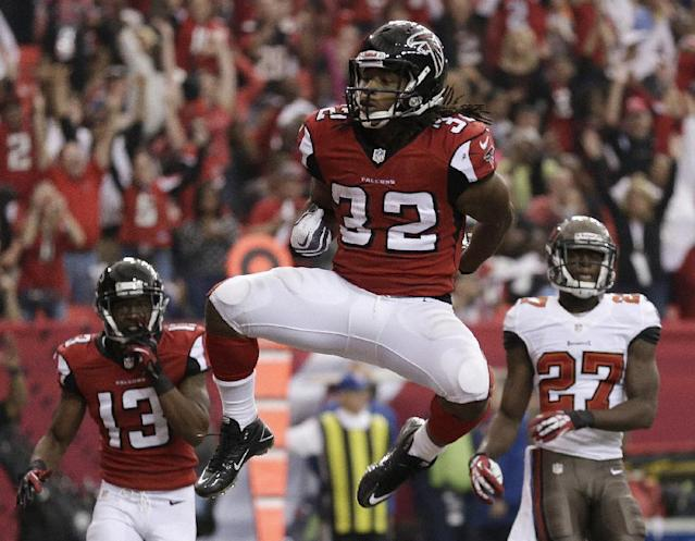 Atlanta Falcons running back Jacquizz Rodgers (32) celebrates his touchdown against the Tampa Bay Buccaneers during the second half of an NFL football game, Sunday, Oct. 20, 2013, in Atlanta. (AP Photo/John Bazemore)