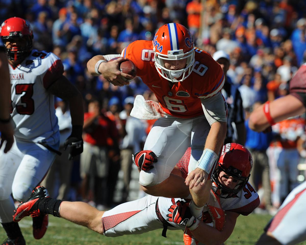 GAINESVILLE, FL - NOVEMBER 10: Quarterback Jeff Driskel #6 of the Florida Gators rushes upfield against the Louisiana-Lafayette Ragin' Cajuns November 10, 2012 in Gainesville, Florida. Driskel was injured and Florida won 27 - 20. (Photo by Al Messerschmidt/Getty Images)
