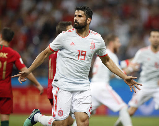 Spain's Diego Costa celebrates his side's equalizing goal during the group B match between Portugal and Spain at the 2018 soccer World Cup in the Fisht Stadium in Sochi, Russia, Friday, June 15, 2018. (AP Photo/Francisco Seco)