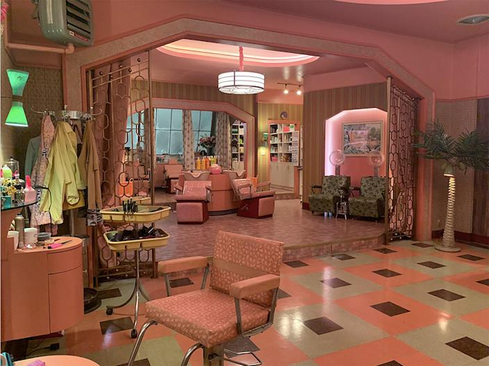 """""""We wanted to make the salon feel feminine,"""" says production designer Nelson Coates of the Art Deco meets '60s–style set. """"Andy [Baseman, set decorator,] found different fabrics that had seen a brighter color in their past, and we found a company who could print an old Formica patterns to place on the tabletops."""""""