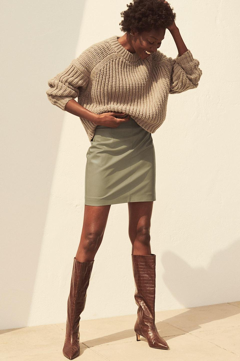 <p>Take a cue from H&M's styling and pair this <span>Faux Leather Skirt</span> ($20) with an oversized sweater and tall croc-skin boots.</p>