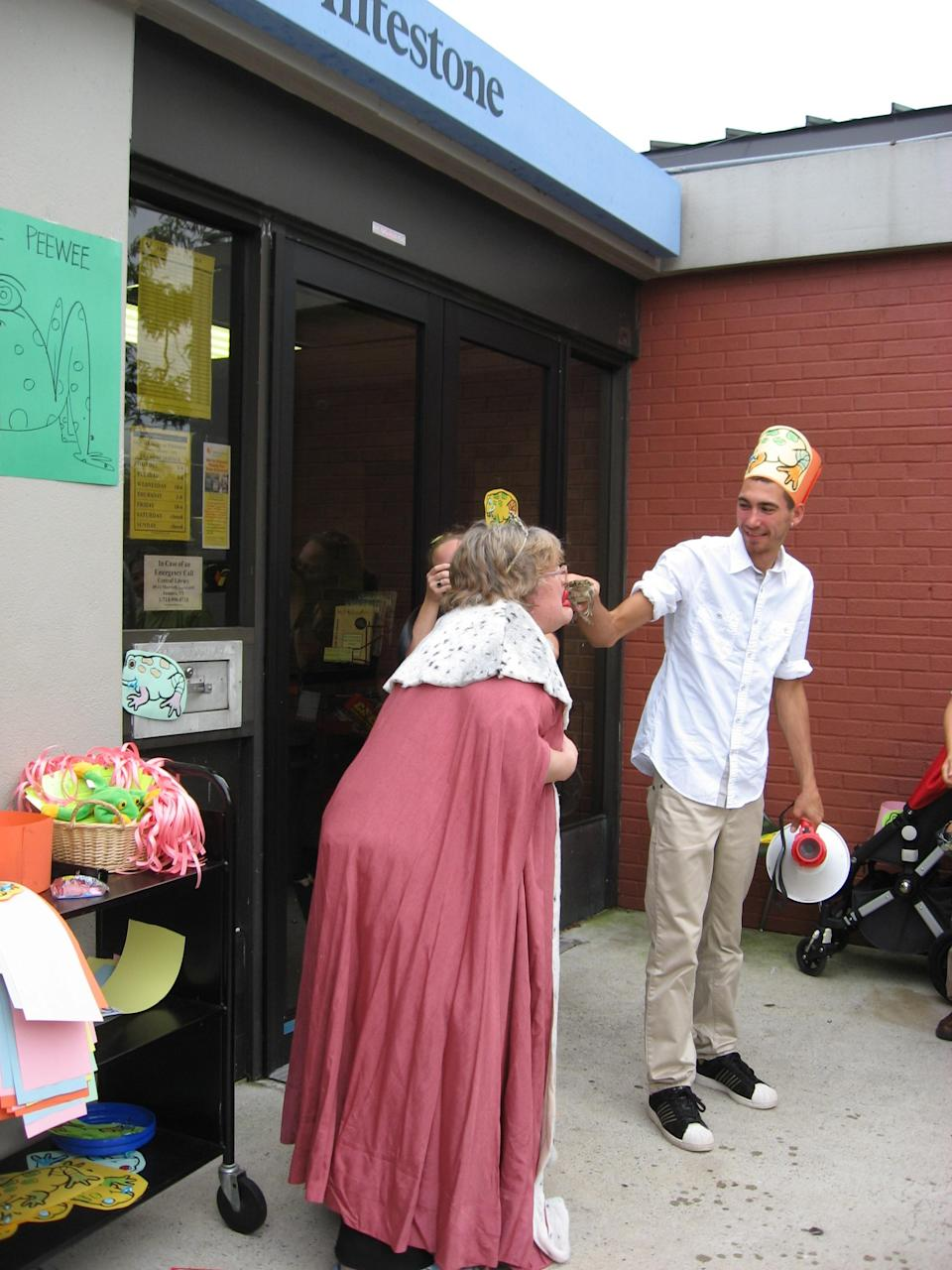 """<div class=""""caption-credit""""> Photo by: Queens Library</div><b>2011 Challenge: Read 3,000 books <br> Final Results: 6,900 books</b> <br> """"I wore wax lips and kissed a frog named Pee Wee,"""" says Scatena. """"Unfortunately, he peed while I was holding him, but it was still fun. After the kiss, I shielded my body with a towel and quickly put on a robe and crown to became a princess."""""""