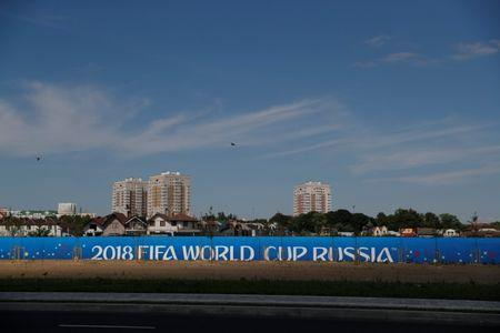 """Birds fly over a """"2018 FIFA World Cup Russia"""" banner outside the stadium in Kaliningrad, Russia, June 28, 2018. REUTERS/Kacper Pempel"""