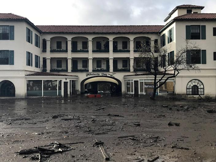 <p>The Montecito Inn sits in flooded waters and debris after a mudslide in Montecito, Calif., Jan. 9, 2018. (Photo: Kenneth Song/Santa Barbara News-Press via Reuters) </p>