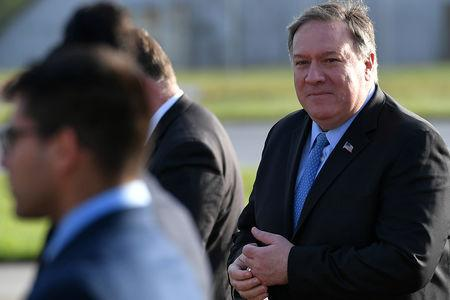 U.S. Secretary of State Mike Pompeo walks to board a plane before departing from London Stansted Airport,