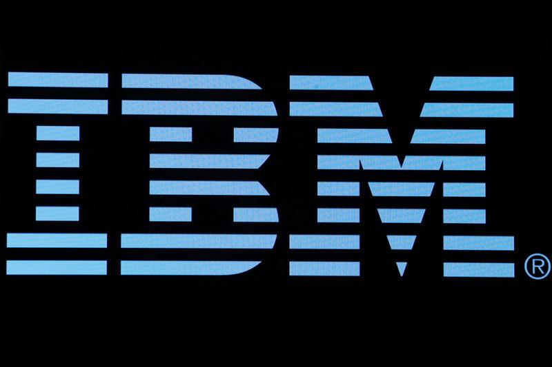 The logo for IBM is displayed on a screen on the floor of the NYSE in New York