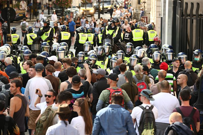 Police presence among demonstrators during an anti-vax protest in London's Trafalgar Square. (Photo: PA)