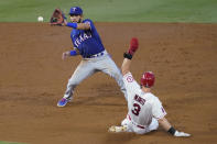 Texas Rangers shortstop Anderson Tejeda, left, catches the throw to second base to force out Los Angeles Angels' Taylor Ward on a grounder by Andrelton Simmons, who reached first during the second inning of a baseball game Friday, Sept. 18, 2020, in Anaheim, Calif. (AP Photo/Ashley Landis)