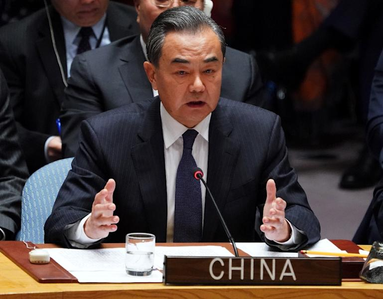Chinese Foreign Minister Wang Yi called for an easing of sanctions on North Korea (AFP Photo/Don EMMERT)