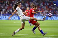 Tobin Heath of the USA is challenged by Jill Scott of England during the 2019 FIFA Women's World Cup France Semi Final match between England and USA at Stade de Lyon on July 02, 2019 in Lyon, France. (Photo by Richard Heathcote/Getty Images)