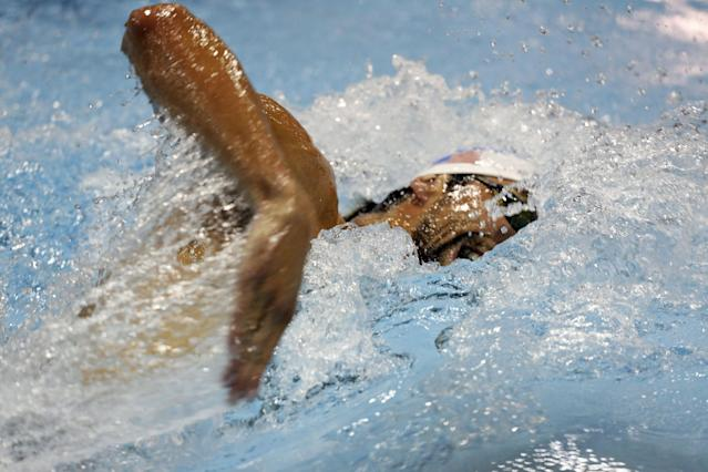 Michael Phelps swims the 200-meter freestyle in a preliminary event at the Arena Grand Prix swim meet in Charlotte, N.C., Friday, May 16, 2014. (AP Photo/Nell Redmond)