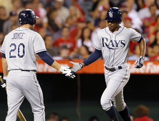 Tampa Bay Rays' B.J. Upton, right, is greeted at the plate by Matt Joyce on his solo home run against the Los Angeles Angels in the fourth inning of a baseball game in Anaheim, Calif., Thursday, Aug. 16, 2012. (AP Photo/Reed Saxon)