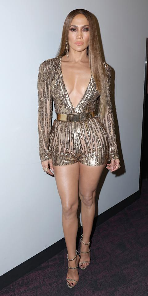 "<p>The ""Ain't Your Mama"" singer continued the all-in-one trend but upped the wow factor: We honestly didn't even think it was possible. She opted for another one of her go-to houses in a shimmering Elie Saab playsuit that showcased her killer legs. The neckline was plunging too--a Lopez trademark.</p>"