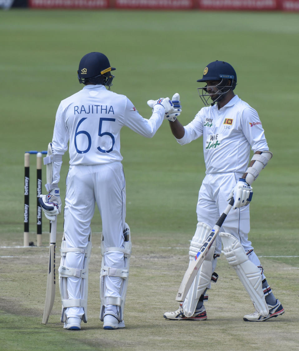 Sri Lanka's Dasun Shanaka's 50 is acknowledged by his teammate Sri Lanka's Kasun Rajitha on day two of the first cricket test match between South Africa and Sri Lanka at Super Sport Park Stadium in Pretoria, South Africa, Sunday, Dec. 27, 2020. (AP Photo/Catherine Kotze)