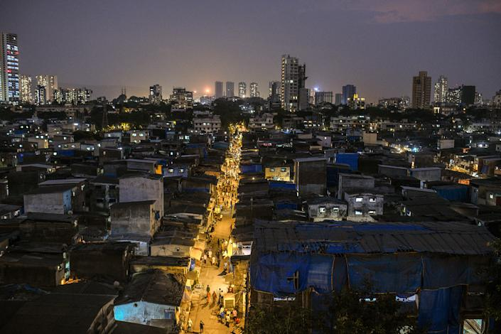 """Dharavi in late April. The hyper-dense network of brick homes and small scale enterprises, which sprawl in the shadow of shiny new skyscrapers, was home to a thriving economy—until recently.<span class=""""copyright"""">Atul Loke—The New York Times/Redux</span>"""