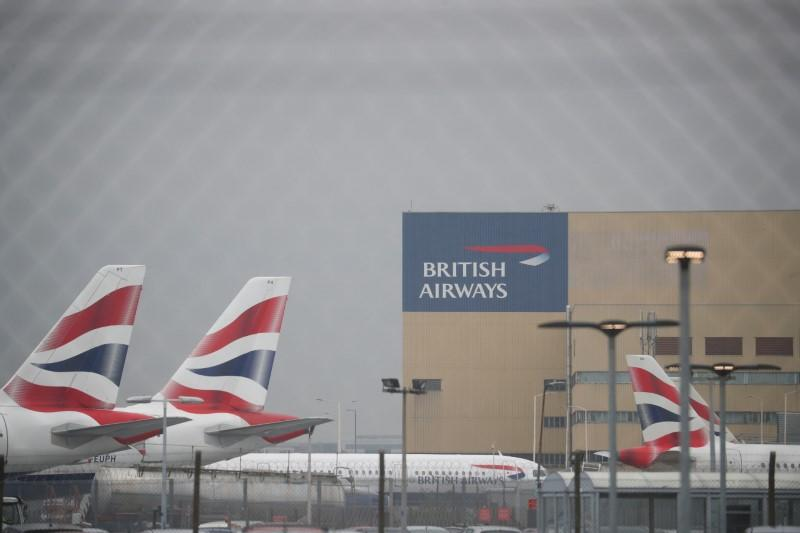 Parked British Airways planes are seen at Heathrow Airport in London