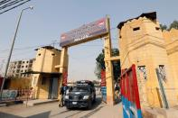 A police vehicle moves through the entrance of the Central Prison in Karachi