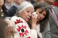Attendees embrace during the Truth and Reconciliation Commission of Canada closing ceremony at Rideau Hall in Ottawa June 3, 2015. REUTERS/Blair Gable