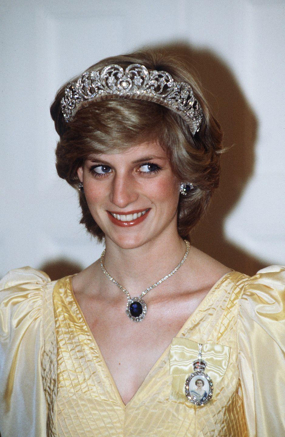 <p>In her royal role, Princess Di often wore beautiful crowns and tiaras (here in 1983) from the royal collection.</p>