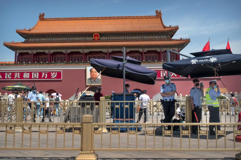 """In this Wednesday, May 20, 2020, photo, Chinese police stand guard in front of Tiananmen Gate in Beijing. This year's version of China's biggest political meeting of the year will be unlike any other. Delayed from March because of the then-spiraling coronavirus outbreak, the decision to go ahead with the gathering signals a partial return to normalcy in the country where the pandemic first broke out. """"Partial"""" being the operative word: The congress will be far from normal. (AP Photo/Mark Schiefelbein)"""