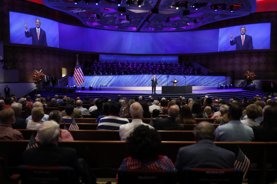 """FILE - In this Sunday, June 28, 2020 file photo, Senior Pastor Robert Jeffress addresses attendees before Vice President Mike Pence was to speak at the First Baptist Church Dallas during a Celebrate Freedom Rally in Dallas. Concerning the COVID-19 pandemic, the prominent megachurch leader has said, """"If we wanted to have zero risks, the safest thing would be to never open our doors. ... The question is how can you balance risk with the very real need to worship."""" (AP Photo/Tony Gutierrez)"""