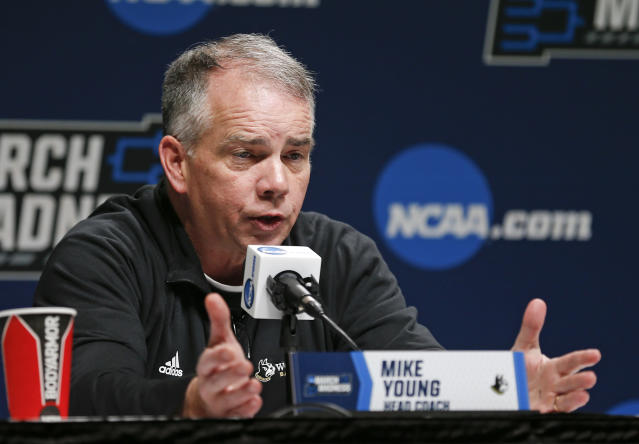 Wofford head coach Mike Young answers questions during a news conference at the NCAA mens college basketball tournament in Jacksonville, Fla., Friday, March 22, 2019. Wofford faces Kentucky in the second round on Saturday. (AP Photo/Stephen B. Morton)