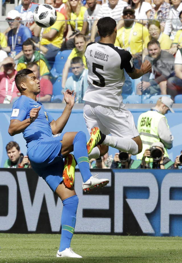 Brazil's Casemiro, left, and Costa Rica's Celso Borges battle for the ball during the group E match between Brazil and Costa Rica at the 2018 soccer World Cup in the St. Petersburg Stadium in St. Petersburg, Russia, Friday, June 22, 2018. (AP Photo/Andre Penner)