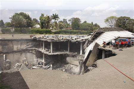 A general view shows the destruction at the Westgate Shopping Centre in Nairobi following a string of explosions during a stand-off between Kenyan security forces and gunmen inside the building in this handout picture provided by the Presidential Strategic Communications Unit September 26, 2013. REUTERS/Presidential Strategic Communications Unit/Handout via Reuters