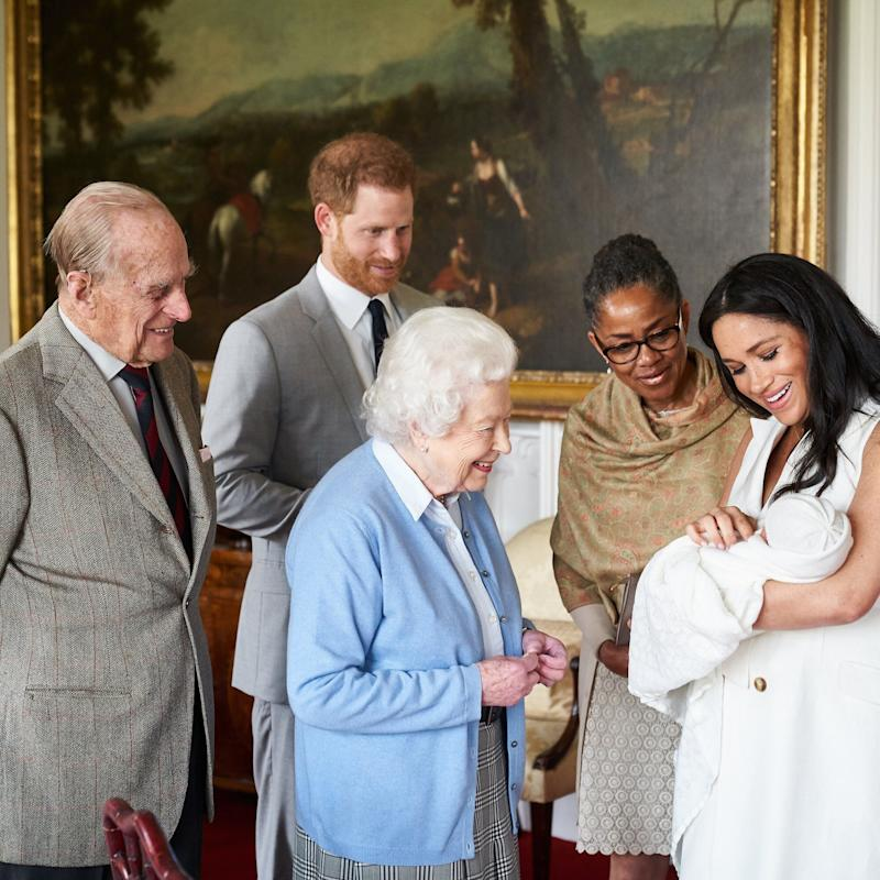 The Duke and Duchess of Sussex are joined by her mother, Doria Ragland, as they show their son Archie Harrison Mountbatten-Windsor, to the Queen Elizabeth and Prince Philip [Photo: Chris Allerton]