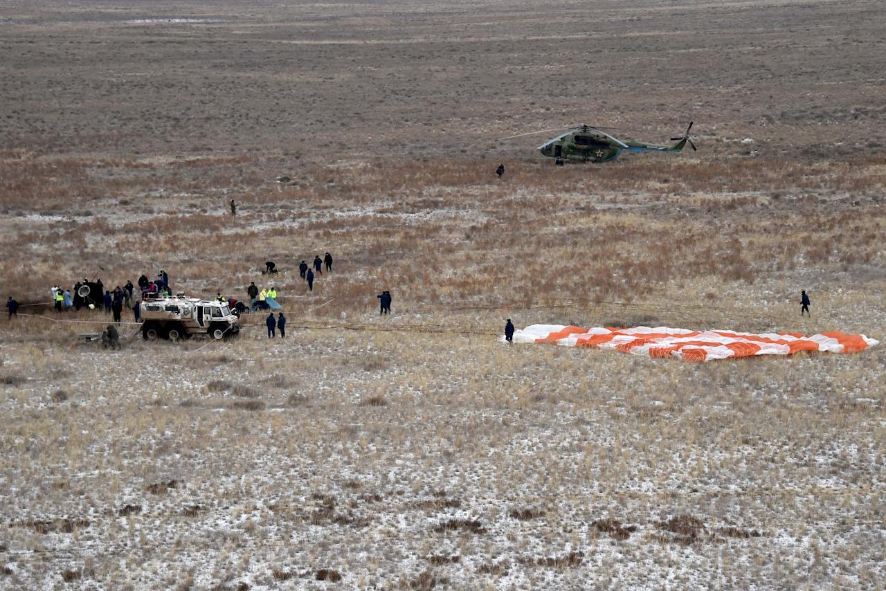 Members of a search and rescue team work at the site of landing of the Soyuz TMA-18M spacecraft, which carried International Space Station (ISS) crew members U.S. astronaut Scott Kelly, Russian cosmonauts Sergei Volkov and Mikhail Korniyenko near the town of Dzhezkazgan (Zhezkazgan), Kazakhstan, March 2, 2016. REUTERS/Kirill Kudryavtsev/Pool