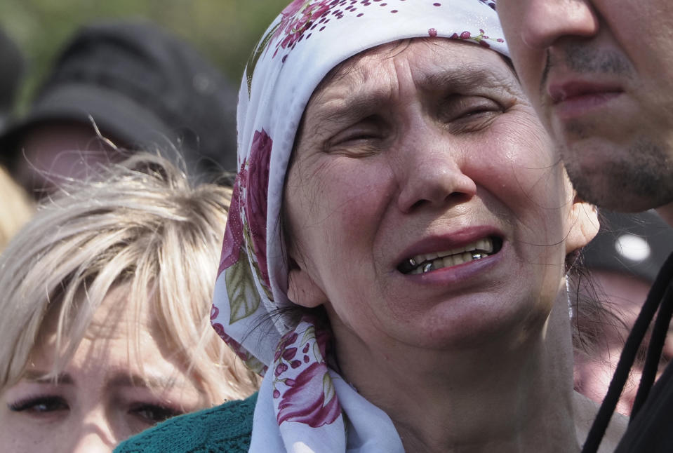 A woman cries during the funeral of Elvira Ignatieva, an English language teacher who was killed at a school shooting on Tuesday in Kazan, Russia, Wednesday, May 12, 2021. Russian officials say a gunman attacked a school in the city of Kazan and Russian officials say several people have been killed. Officials said the dead in Tuesday's shooting include students, a teacher and a school worker. Authorities also say over 20 others have been hospitalised with wounds. (AP Photo/Dmitri Lovetsky)
