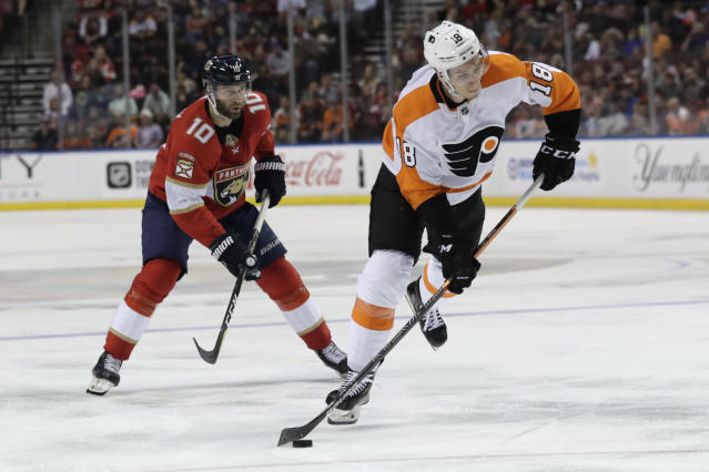 Philadelphia Flyers center Tyler Pitlick (18) prepares to shoot as Florida Panthers right wing Brett Connolly (10) defends during the second period of an NHL hockey game Thursday, Feb. 13, 2020, in Sunrise, Fla. (AP Photo/Lynne Sladky)