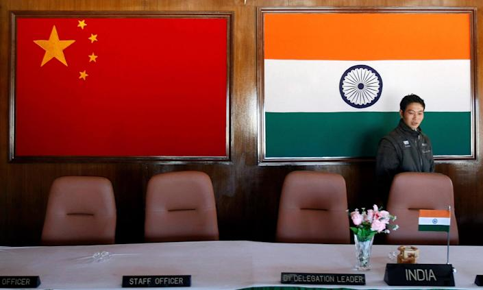 Image: A man walks inside a conference room used for meetings between military commanders of China and India, at the Indian side of the Indo-China border at Bumla, in the northeastern Indian state of Arunachal Pradesh. (Adnan Abidi / Reuters file)