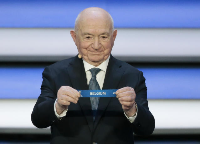 Former Russian soccer player Nikita Simonyan holds up the team name of Belgium the 2018 soccer World Cup draw. (AP)