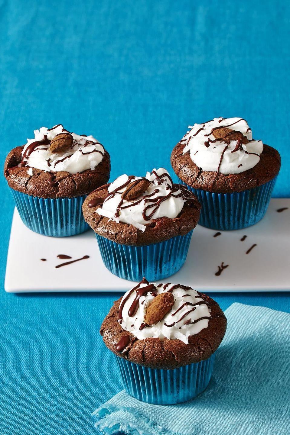 """<p>Turn your favorite coconut candy bar into these tasty gluten-free cupcake treats. </p><p><a href=""""https://www.womansday.com/food-recipes/food-drinks/recipes/a58122/almond-joy-cupcakes-recipes/"""" rel=""""nofollow noopener"""" target=""""_blank"""" data-ylk=""""slk:Get the recipe from Woman's Day »"""" class=""""link rapid-noclick-resp""""><em>Get the recipe from Woman's Day »</em></a></p>"""