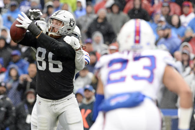 <p>Oakland Raiders tight end Lee Smith (86) reaches to make a catch as Buffalo Bills defensive back Trae Elston, back left, defends during the first half of an NFL football game, Sunday, Oct. 29, 2017, in Orchard Park, N.J. Bills strong safety Micah Hyde (23) looks on during the play. (AP Photo/Adrian Kraus) </p>