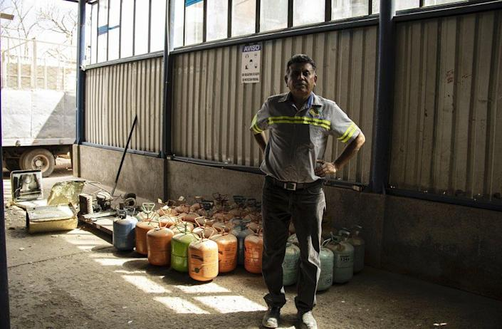 Angel with canisters of refrigerant gases