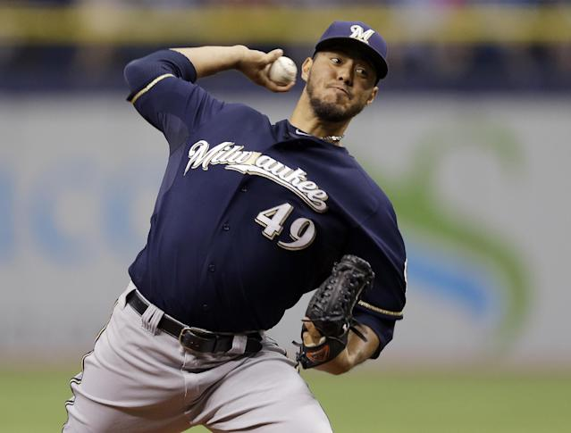 Milwaukee Brewers starting pitcher Yovani Gallardo delivers to the Tampa Bay Rays during the first inning of an interleague baseball game Wednesday, July 30, 2014, in St. Petersburg, Fla. (AP Photo/Chris O'Meara)